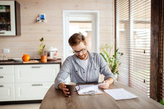 Man signing master lease for commercial real estate